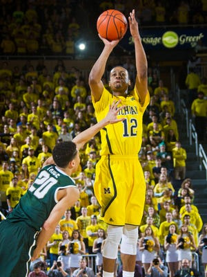 Michigan guard Muhammad-Ali Abdur-Rahkman shoots a jump shot over Michigan State guard Travis Trice on Tuesday at Crisler Center in Ann Arbor.