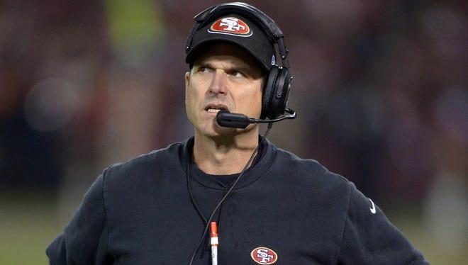 San Francisco 49ers coach Jim Harbaugh reacts during the final regular season game at Candlestick Park against the Atlanta Falcons.