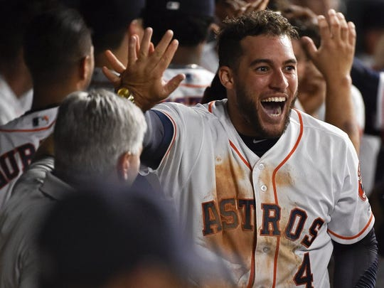 Houston Astros' George Springer (4) celebrates scoring a run on Marwin Gonzalez' two-run single in the sixth inning of a baseball game against the Seattle Mariners, Tuesday, in Houston. (AP Photo/Eric Christian Smith)