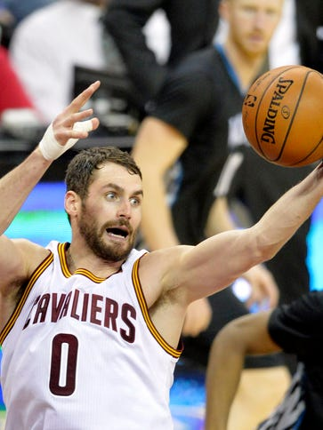 Cleveland Cavaliers forward Kevin Love (0) grabs a