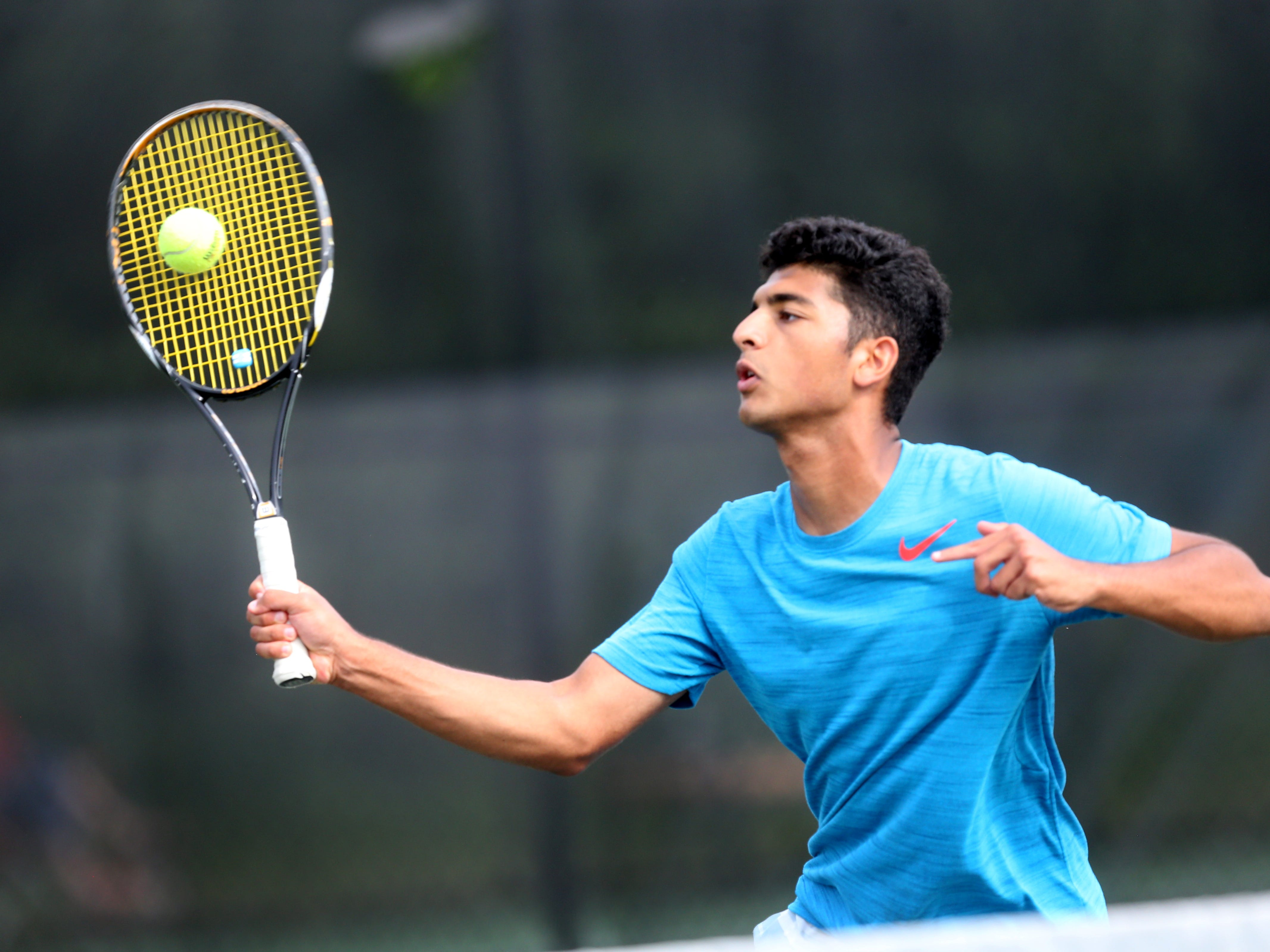 Siegel's Mohammed Al-Zubaidi returns a ball during a doubles match with his partner Ben Betzler as they play against another Siegel doubles team during the boys doubles Regional 4-AAA Tournament held at Old Fort Park on May 11.