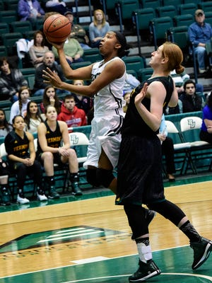 Binghamton's Imani Watkins leaps towards the net while being covered by Vermont's Emilie Cloutier during Saturday's women's basketball game at the Event Center.