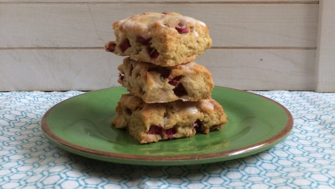 Tart rhubarb scones are topped with a sweet glaze.