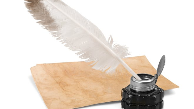 Feather Quill, Inkwell and an Old Page