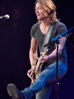 Keith Urban performs a tribute to Rodney Crowell at the 55th annual American Society of Composers, Authors and Publishers (ASCAP) Country Music Awards Monday, Nov. 6, 2017, at the Ryman Auditorium in downtown Nashville, Tenn.
