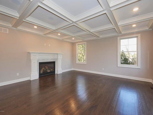 The great room features immaculate hardwood floors