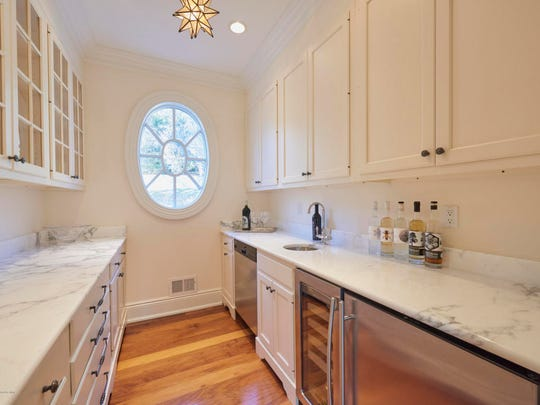 The home offers a butler's pantry with granite stone countertops and hardwood flooring.