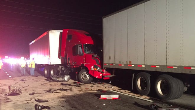 Debris is scattered along northbound I-69 neat 96th Street on Thursday after a fatal wreck