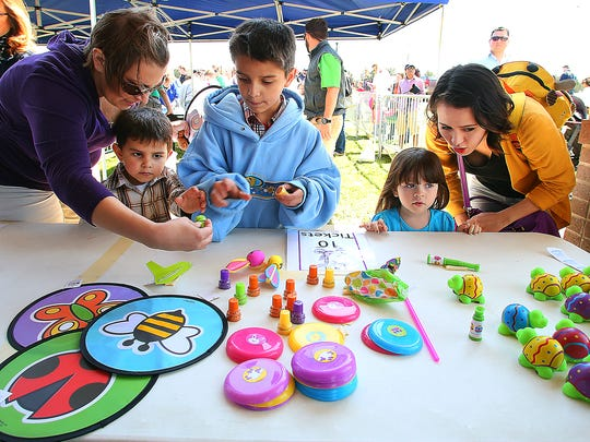 Children can do crafts and games after the Citywide Easter Egg Hunt in Murfreesboro.