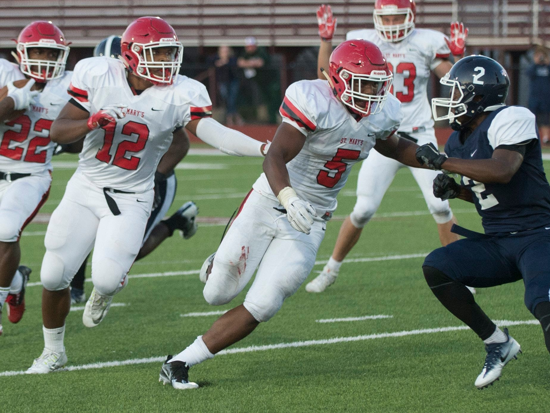 Orchard Lake St. Mary's linebacker Josh Ross, 5, crashes into Detroit Loyola defensive back Cartiae Mitchell during St. Mary's 35-14 win Friday at Hazel Park.