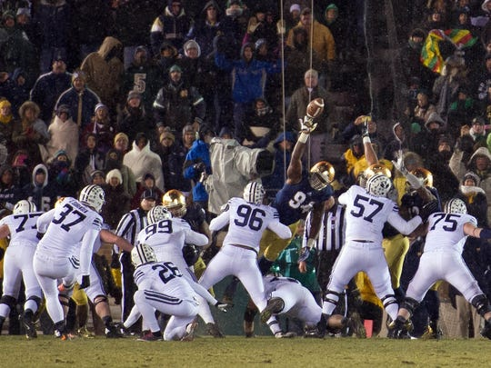 BYU Cougars kicker Justin Sorensen attempts a field goal as Notre Dame Fighting Irish defensive end Jarron Jones (94) blocks the kick in the fourth quarter at Notre Dame Stadium. Notre Dame won 23-13 on Nov 23, 2013.