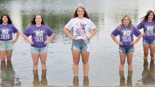 2019 Miss Crookston Sophia Steiner and the 2020 pageant contestants pose in one of the ponds in Nature's View Estates. Left to right are Shelby Aamoth, Linnea French, Victoria Proulx, Savannah Meine, Emily Funk and Emma Boll.