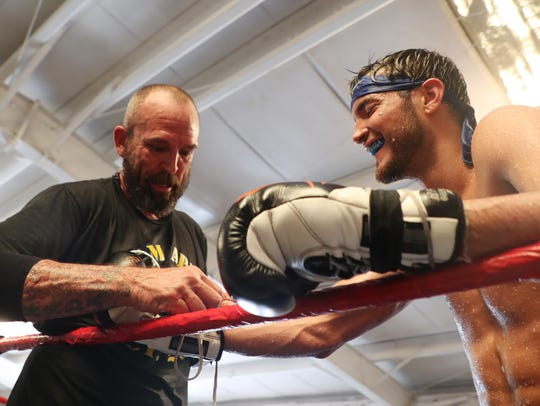 Bryant Perrella 15-1 trains with his head trainer Mike Nowling at Syndicate Boxing Club in south Fort Myers on Monday. He is fighting former welterweight champion Luis Collazo, 37-7 (20 KO's), August 4 at the Nassau Coliseum in Uniondale, NY.