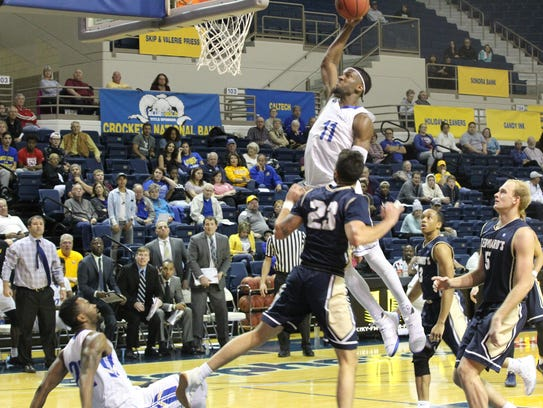 Angelo State University's Brandon Williams (11) goes