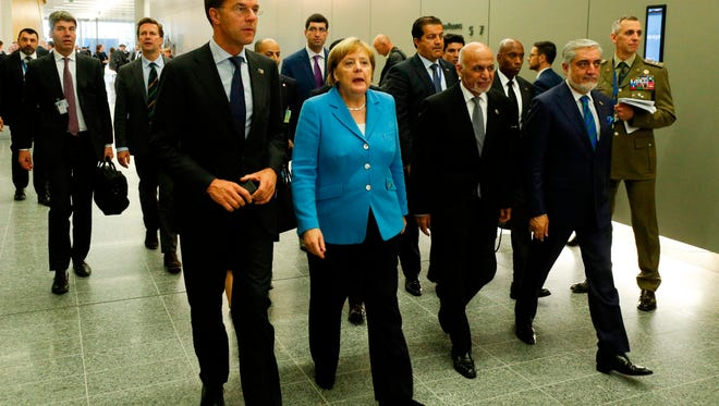 (L/R): Netherlands' Prime Minister Mark Rutte, Germany's Chancellor Angela Merkel, Afghanistan's President Ashraf Ghani and Afghan Chief Executive Abdullah Abdullah walk between meetings on the second day of the North Atlantic Treaty Organization (NATO) summit in Brussels on July 12, 2018.  / AFP PHOTO / GEOFFROY VAN DER HASSELTGEOFFROY VAN DER HASSELT/AFP/Getty Images ORIG FILE ID: AFP_17J5AP