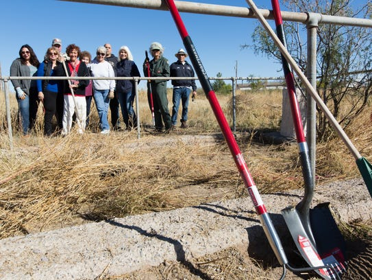Former state Rep. Mary Jane Garcia gathers committee members and volunteers as they begin to clean up the historic Doña Ana Cemetery on Saturday, Nov. 18, 2017.