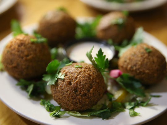 Falafel is served up with appetizers at Cedar Restaurant, 746 Monroe Ave.