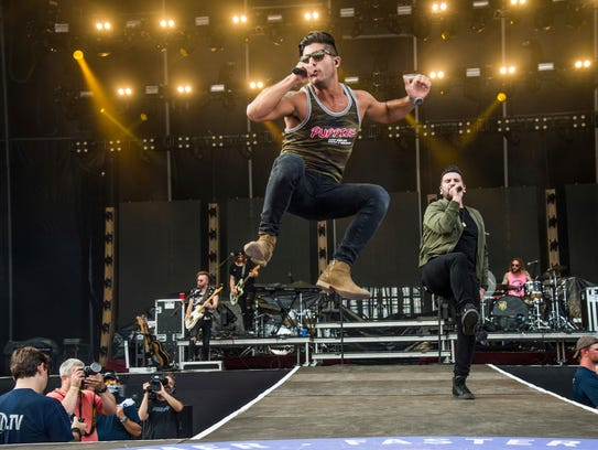 Dan Smyers, left, and Shay Mooney of Dan + Shay perform at the Faster Horses Music Festival in the Brooklyn Trails Campground at Michigan International Speedway on Saturday, July 22, 2017, in Brooklyn, Mich.