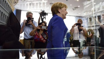 German Chancellor Angela Merkel leaving after a press conference in Berlin on Thursday.