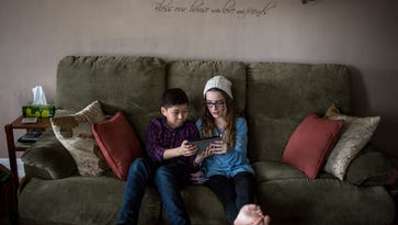 Logan McCulloch, 12, relaxes on the couch with his sister, Scout, 13, Saturday, Jan. 14, 2017 in Port Huron.