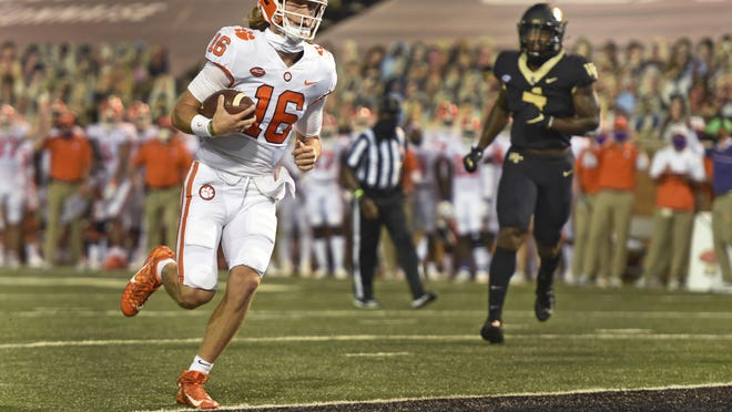 Clemson quarterback Trevor Lawrence is untouched as he scores in the first half of an NCAA college football game against Wake Forest, Saturday, Sept. 12, 2020 at Truist Field in Winston-Salem, N.C.