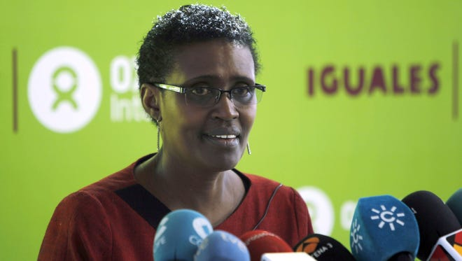 """Oxfam International's executive director, Winnie Byanyima, addresses a press conference to launch the report """"Equal. Put an end to Extreme Inequality"""" in Madrid on Oct. 30, 2014."""