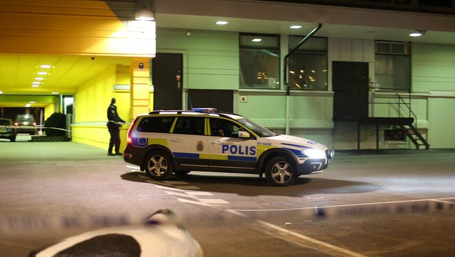A police officer stands next to the scene of a fatal shooting in Gothenburg, Sweden.