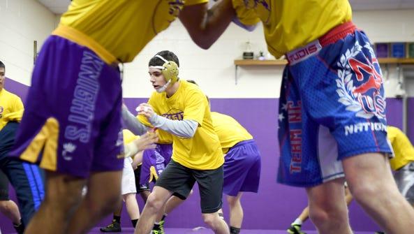 North Henderson's Josh Blatt does drills with his teammates