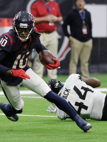 FILE - In this Dec. 30, 2018, file photo, Houston Texans wide receiver DeAndre Hopkins (10) runs past Jacksonville Jaguars middle linebacker Myles Jack (44) after making a catch during the first half of an NFL football game in Houston. The Texans have placed Hopkins on the physically unable to perform list. (AP Photo/David J. Phillip, File)