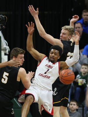 Detroit Edison PSA guard Pierre Mitchell rebounds against Maple City Glen Lake forward Cade Peterson during the first quarter of Edison's 53-38 win in the Class C state title game on Saturday, March 24, 2018, at Breslin Center.