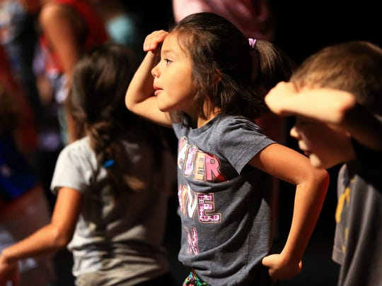 Children practice dancing and singing during the Harbor Playhouse Summer Camp on Wednesday, July 19, 2017, in Corpus Christi.