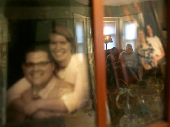 Laurie Frahm and her husband Rick are reflected in