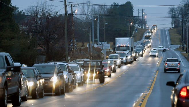 Traffic backs up on Columbia Avenue in Spring Hill during morning rush hour on Feb. 14.
