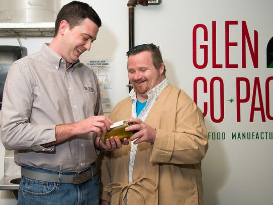 Jeff Dill, left, owner of J.R. Dill Winery and customer