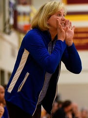 Mary Cicerone, in her 34th season as Marian's head coach, has led the Mustangs to 15 Catholic League tournament titles over the years.