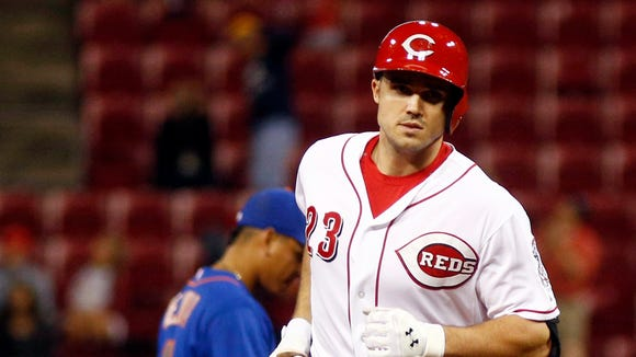 Adam Duvall (23) rounds the bases after hitting a solo
