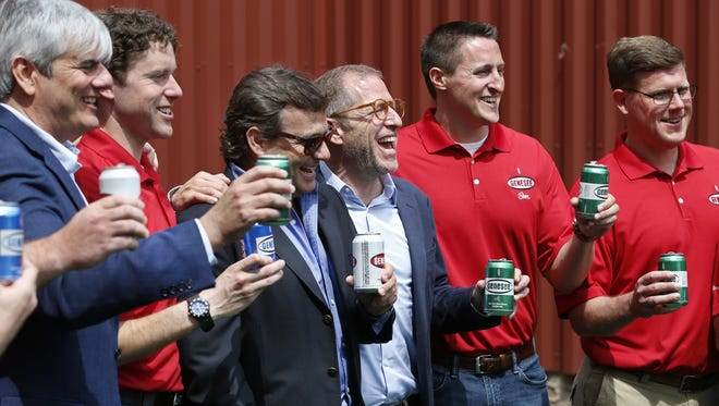 Center, North American Breweries CEO Adrian Lachowski toasts with others during the opening of the $48.5 million Brewhouse and Cold Block at Genesee Brewery.