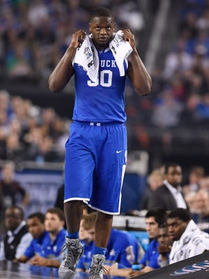 Kentucky Wildcats forward Julius Randle (30) reacts on the sideline against the Connecticut Huskies in the second half during the championship game of the Final Four.