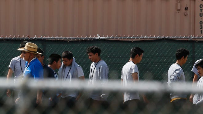 Migrant children walk outside at the Homestead Temporary Shelter for Unaccompanied Children, a former Job Corps site that now houses them, on June 22 in Homestead.