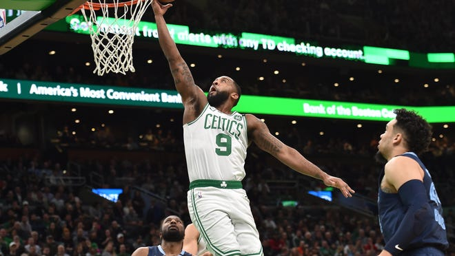 Celtics guard Brad Wanamaker lays the ball in the basket during a game against the  Memphis Grizzlies in January at TD Garden.