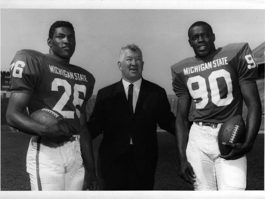 Spartans Clifton Jones, left, and George Webster flank