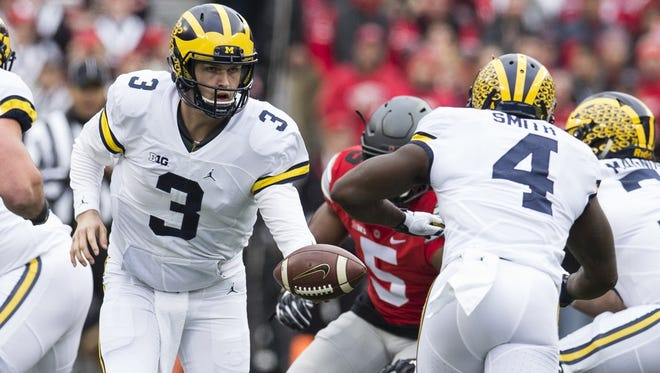 """2. Michigan (10-2, previous rank: 2): Saturday's thriller proved """"The Game"""" featured the two best teams in the conference, no question. And though the Wolverines shot themselves in the foot one too many times at the Horseshoe, they showed they can compete with the absolute best of the Big Ten. The pressure's on for Jim Harbaugh in Year 3 to finally beat OSU, though."""