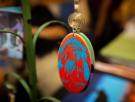 A pendant featuring the likeness of legendary Native