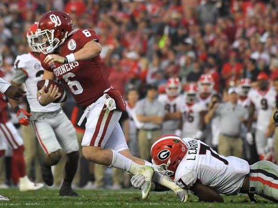 Oklahoma quarterback Baker Mayfield (6) is sacked by Georgia linebacker Lorenzo Carter, right, during the second half of the Rose Bowl NCAA college football game, Monday, Jan. 1, 2018, in Pasadena, Calif. (AP Photo/Mark J. Terrill)