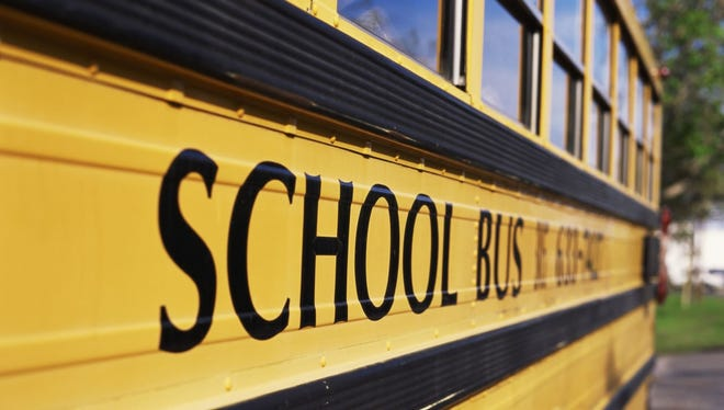A child was bitten by a pit bull Thursday afternoon while getting off of a school bus, Greenville County deputies said.