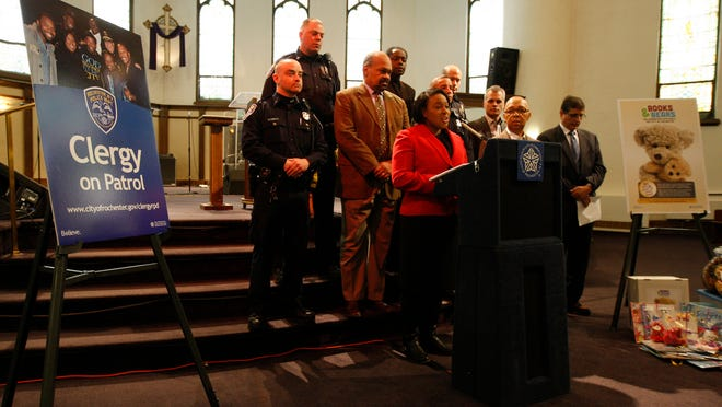 Mayor Lovely Warren and Police Chief Michael Ciminelli hold a news conference last week with clergy supportive of reorganizing police patrols.