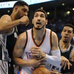 Oklahoma City Thunder center Enes Kanter (34) loses the ball while guarded by San Antonio Spurs forward Tim Duncan (21) and guard Danny Green (14)