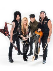 Lita Ford with her band, (from left) guitarist Patrick