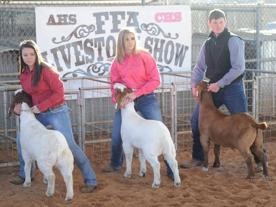 Cooper's Bailie Borrego, left, shows off her goat,