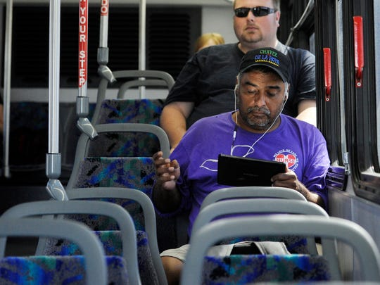 Jerry Torres, pictured, of Visalia rides the #SocialBus Monday just to use the internet on his tablet. Free Wi-Fi will soon be offered to all riders on Visalia Transit buses. Currently the #SocialBus and a few others labeled as such have Wi-Fi available.